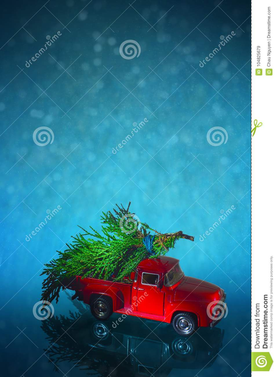 Vintage Miniature Truck Delivers Christmas Tree On Snow Background