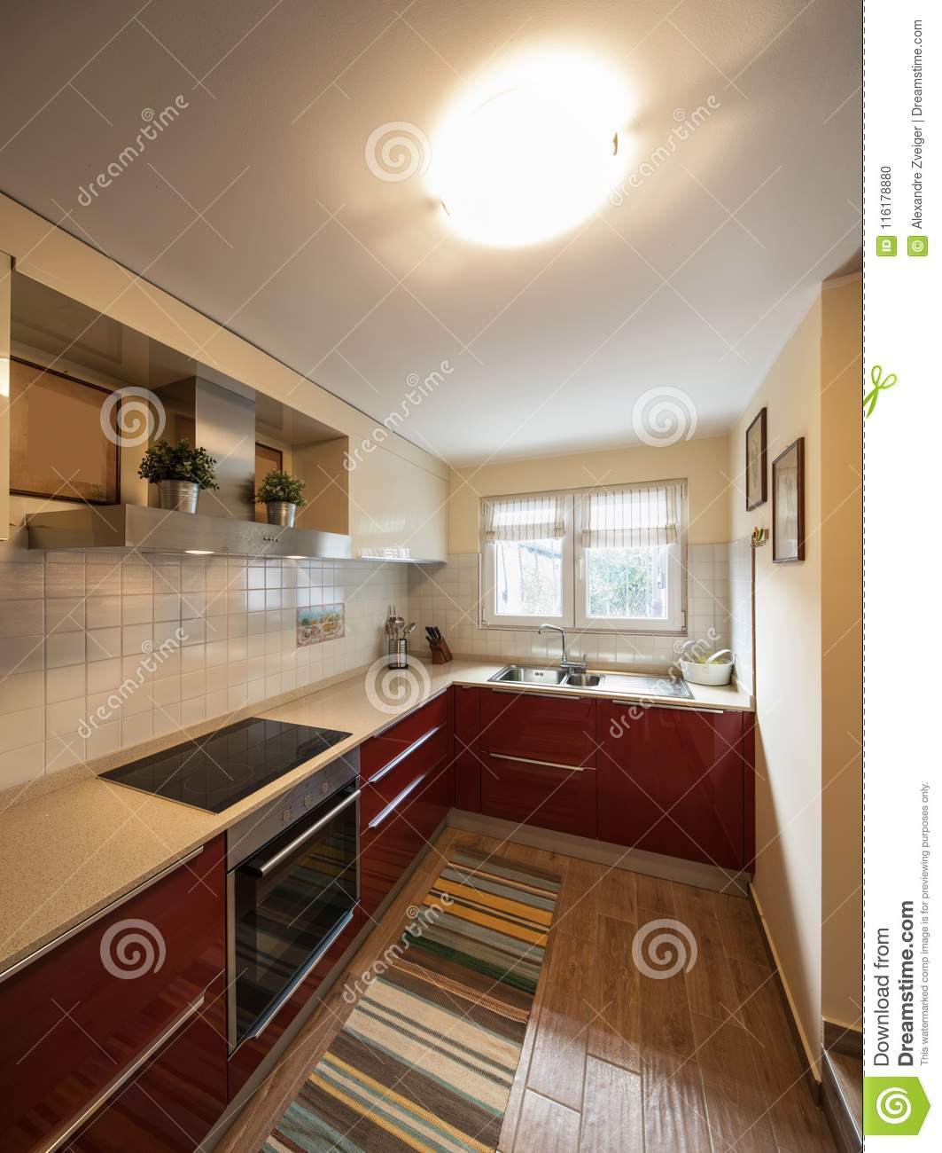 Red modern kitchen with new appliances