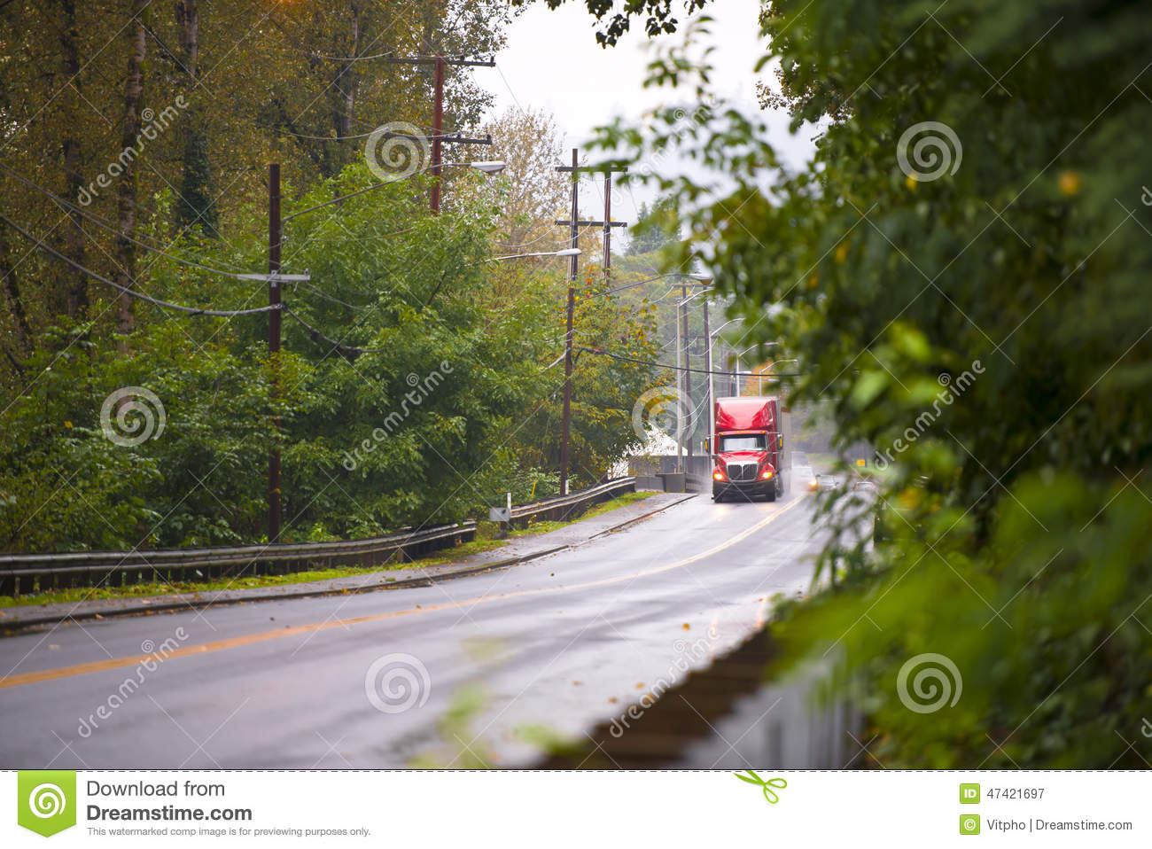 classic big rig truck in raining weather wet road stock photo