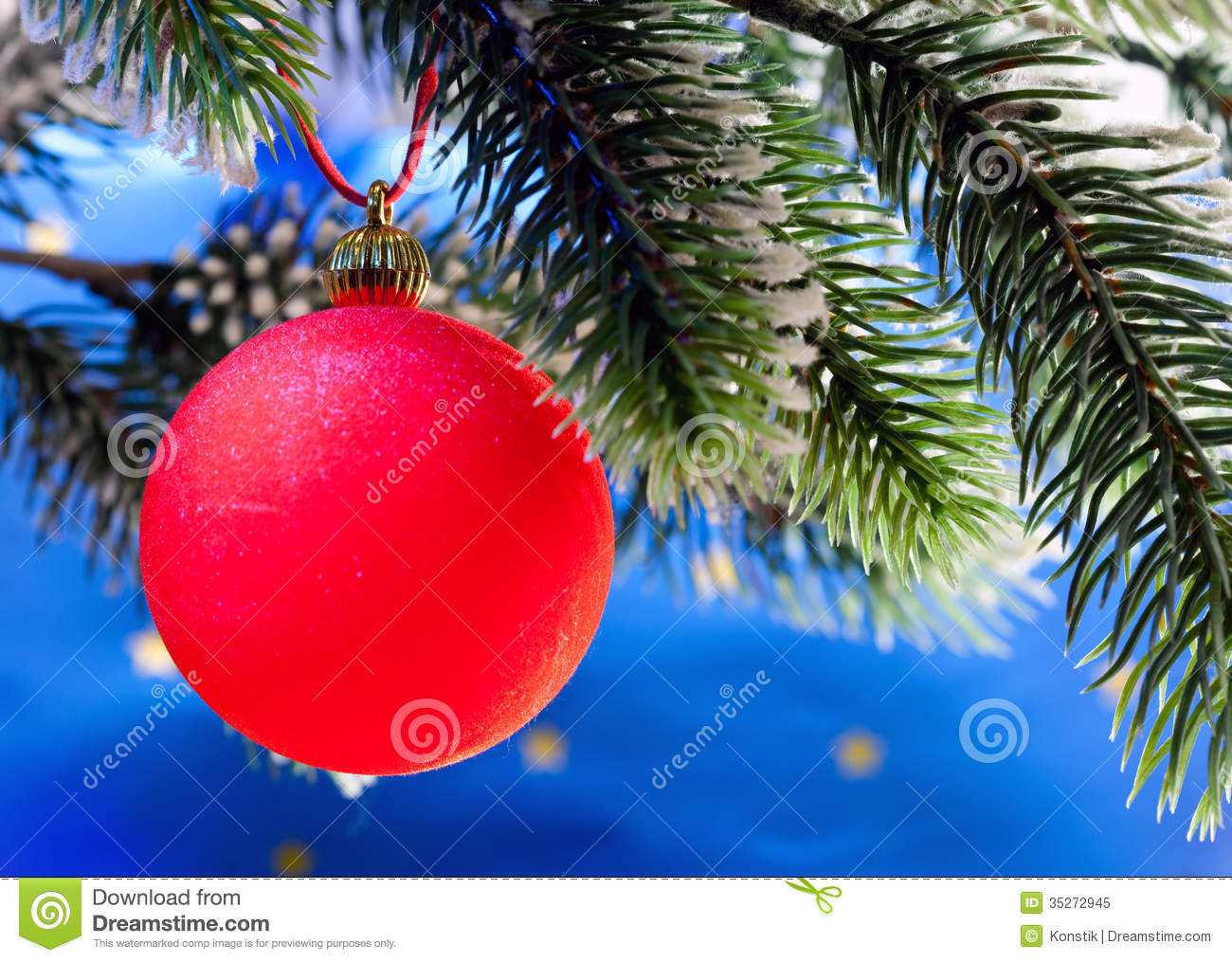Red new year s ball on a branch of christmas tree