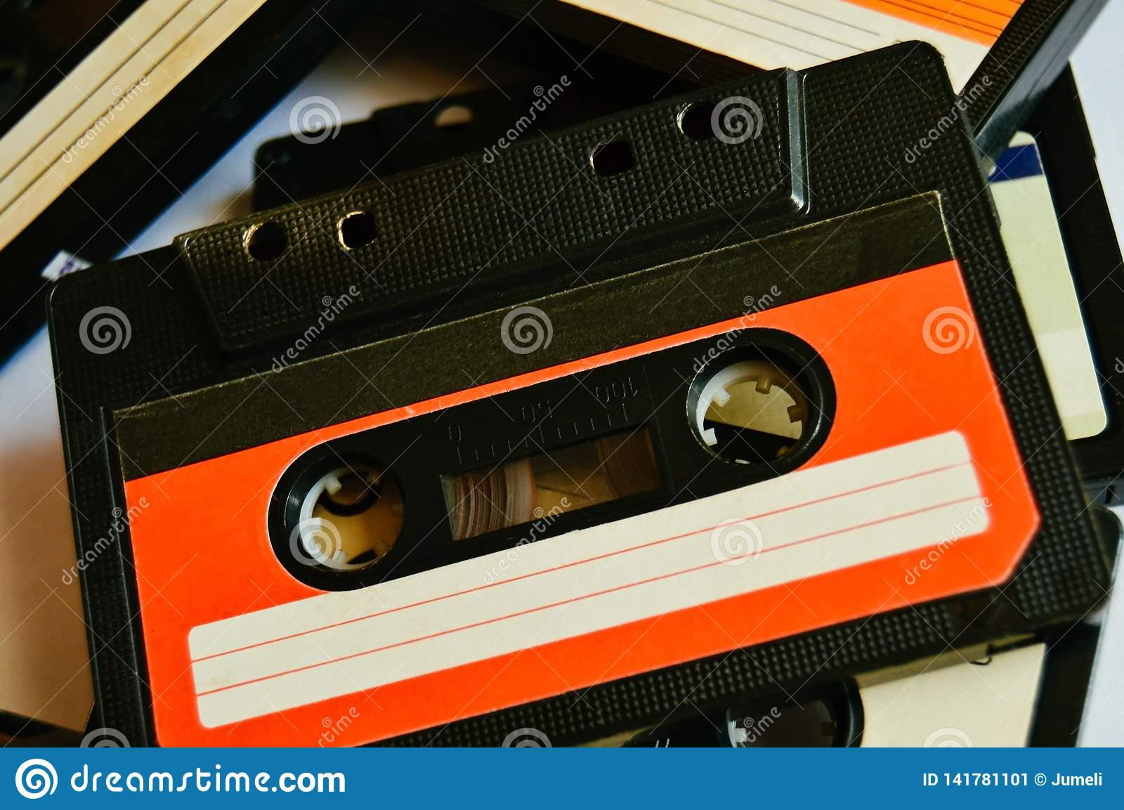 Red old audio cassette background. 80s-90s. Close-up