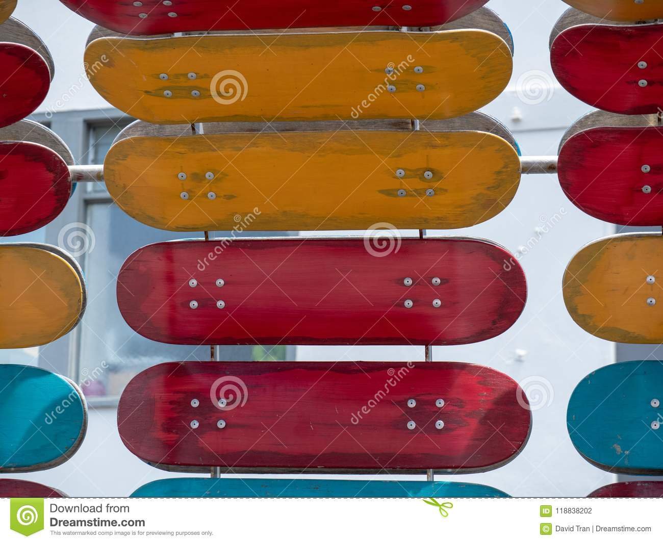 c02114ff A number of red and orange skateboard decks mounted on a structure. More  similar stock images