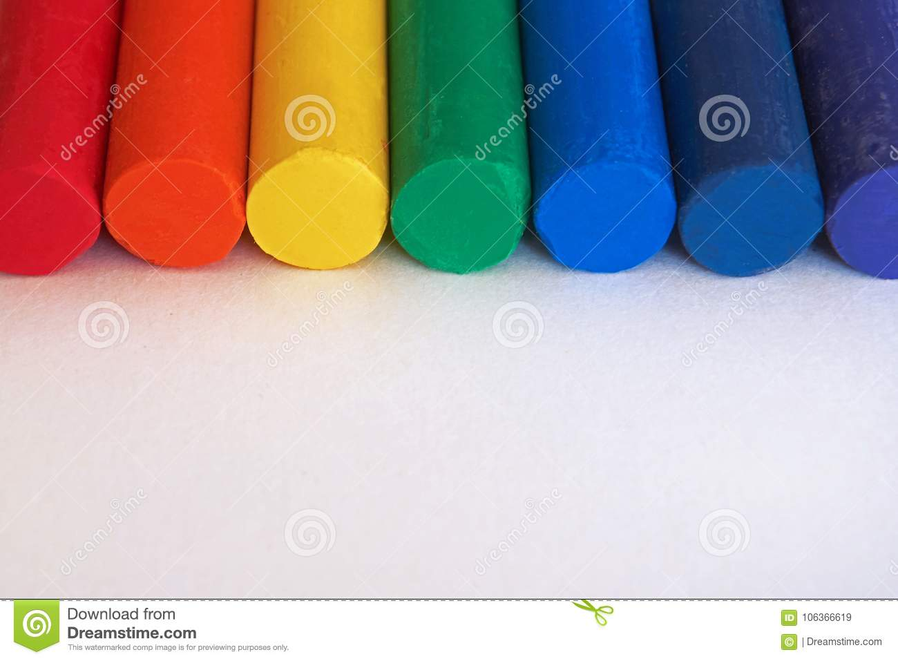 Red, orange, yellow, green, blue, indigo, purple. Rainbow colored crayons are placed side by side.