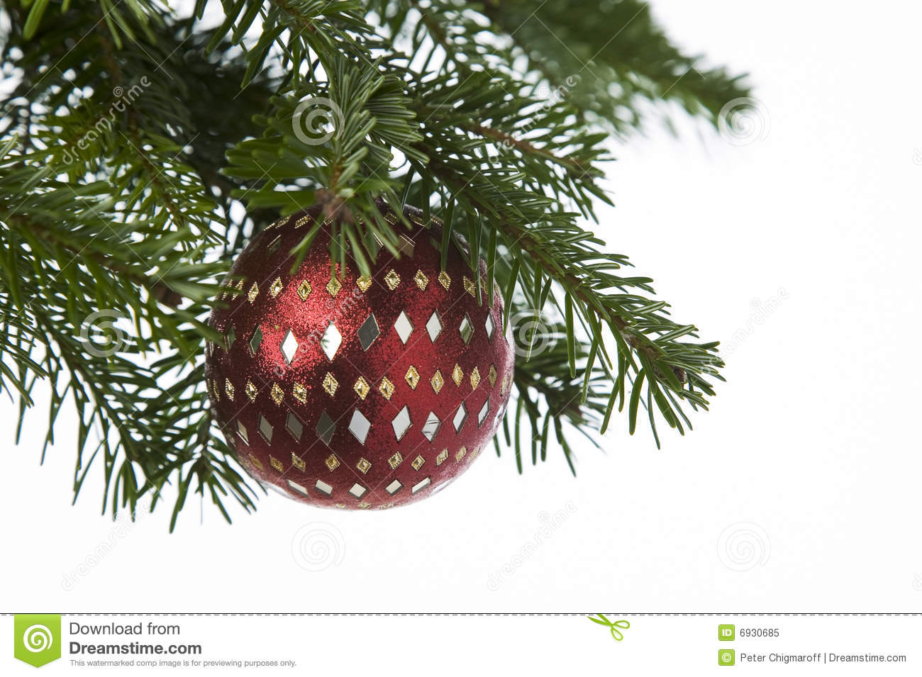 Red Ornament Hanging From A Christmas Tree Royalty Free