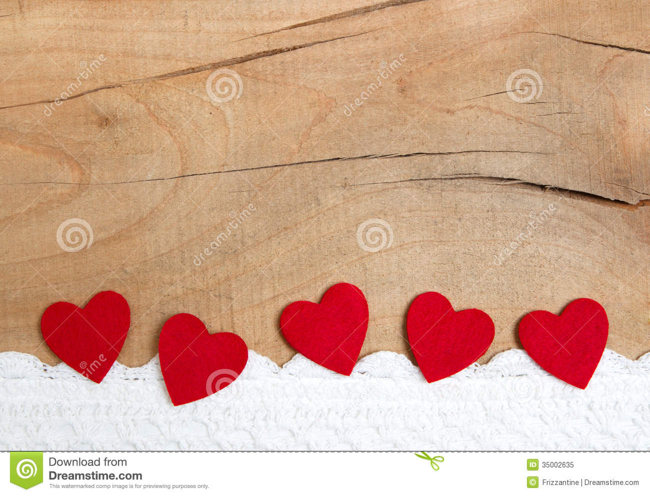 Red Ornamental Hearts On A Wooden Background For Christmas