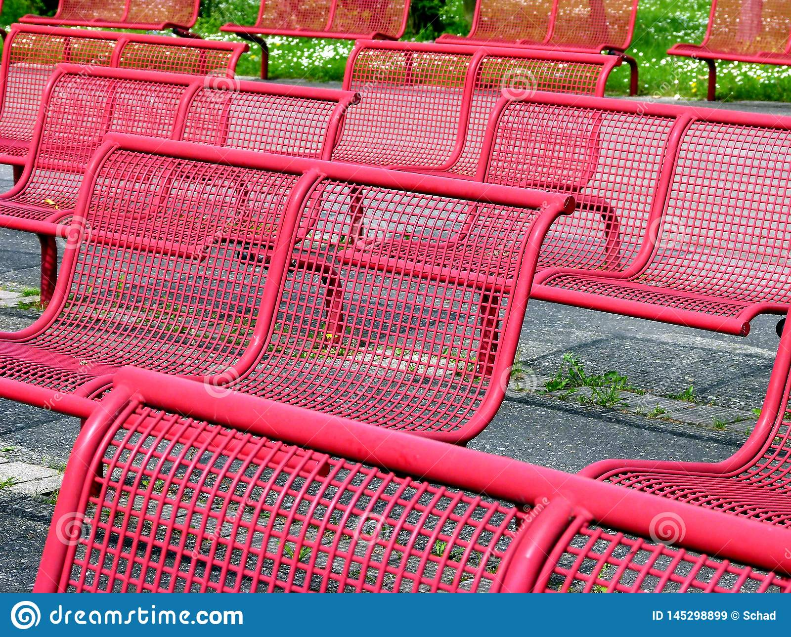 Picture of: Rows With Red Metal Chairs And Green Background Stock Image Image Of Wire Outdoor 145298899