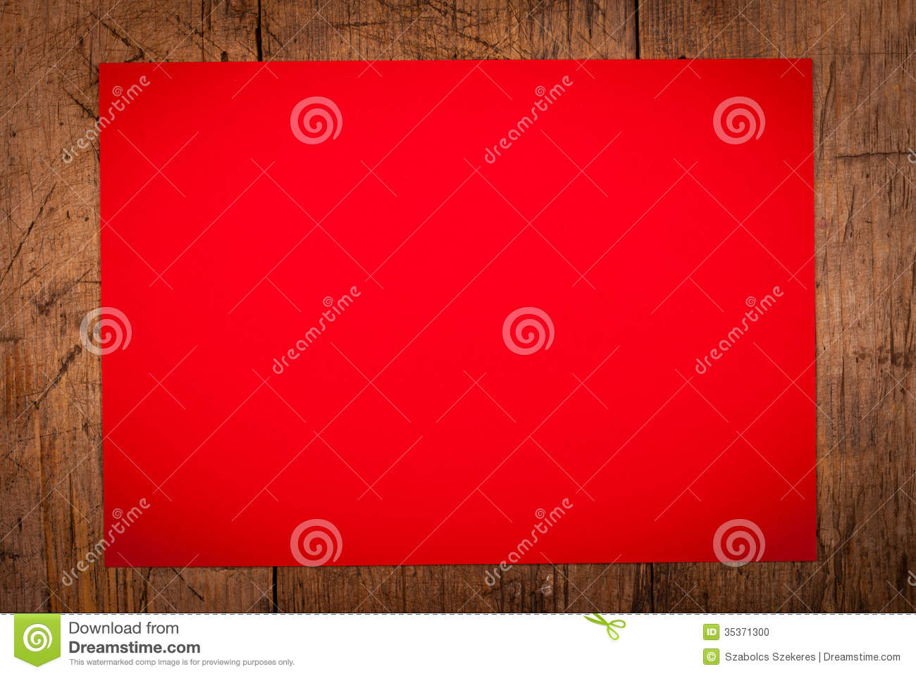 Red Paper As Background On Wooden Table Stock Photo