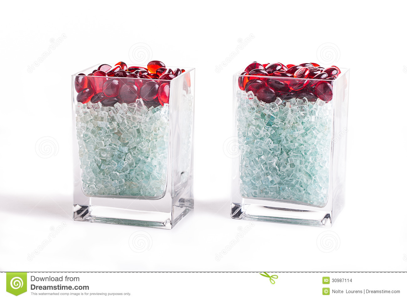 Vase glass pebbles stock photos royalty free pictures red pebbles chipped glass in a glass vase image of two square glass holders reviewsmspy
