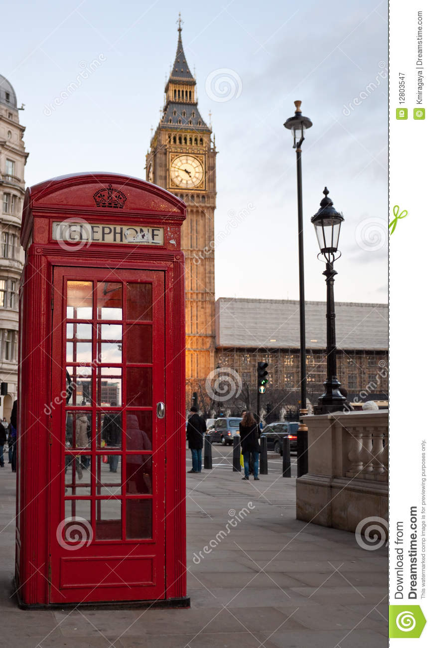 red phone booth with the big ben in the bac royalty free