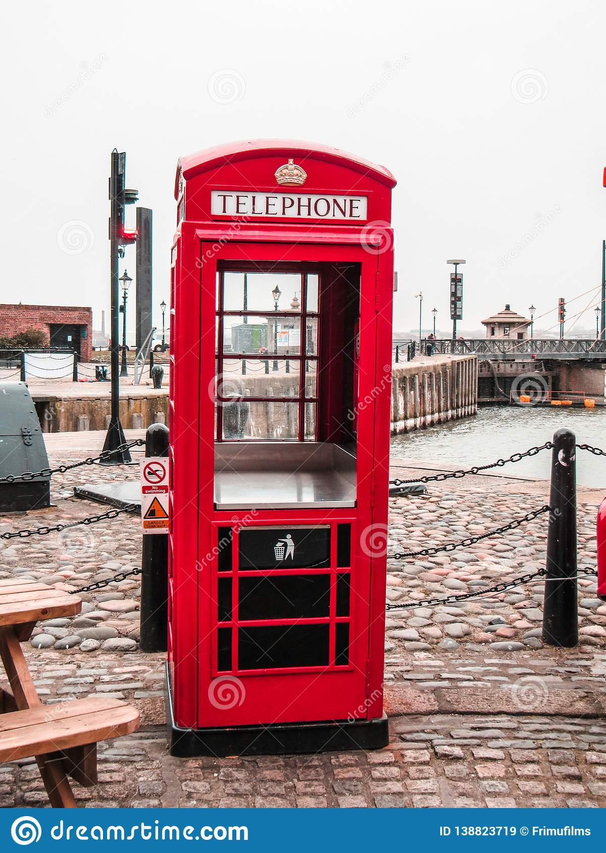 Red phone booth in Liverpool used for throwing trash