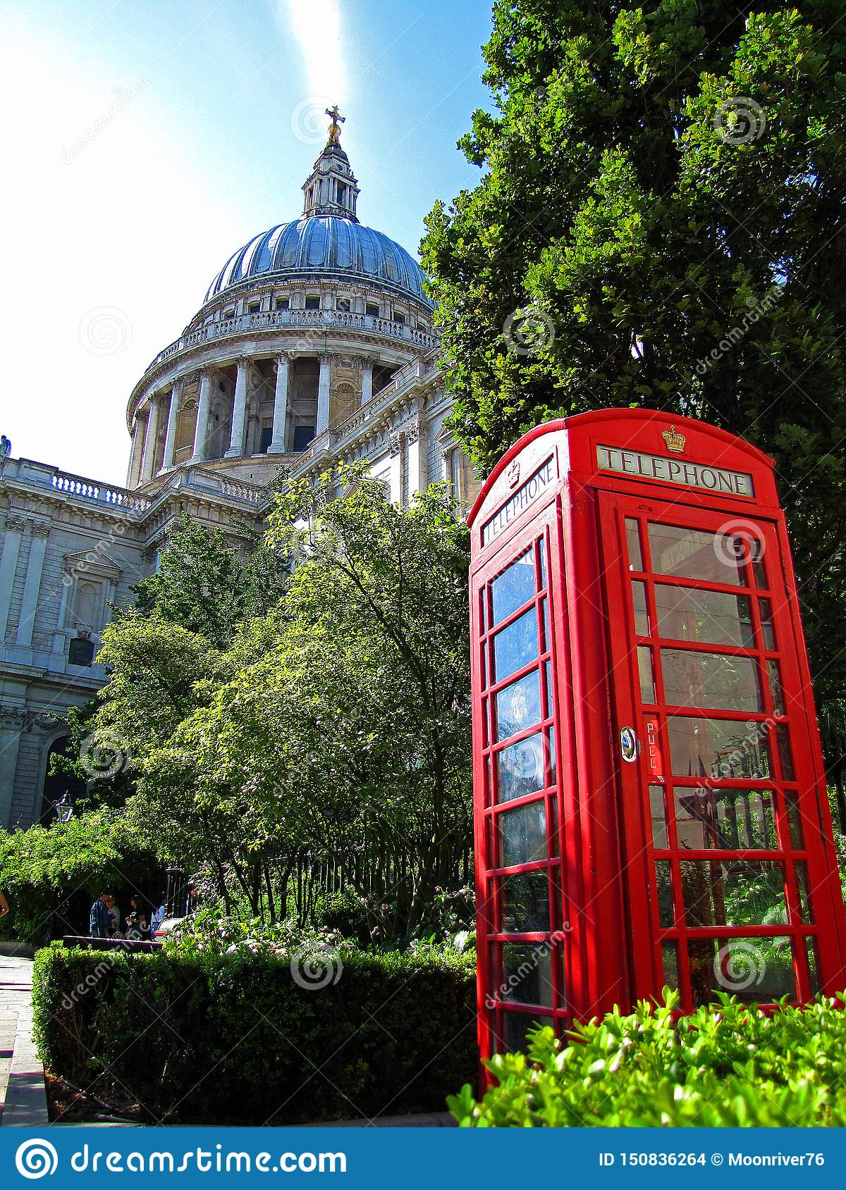 Red phone booth and St. Pauls Cathedral in London
