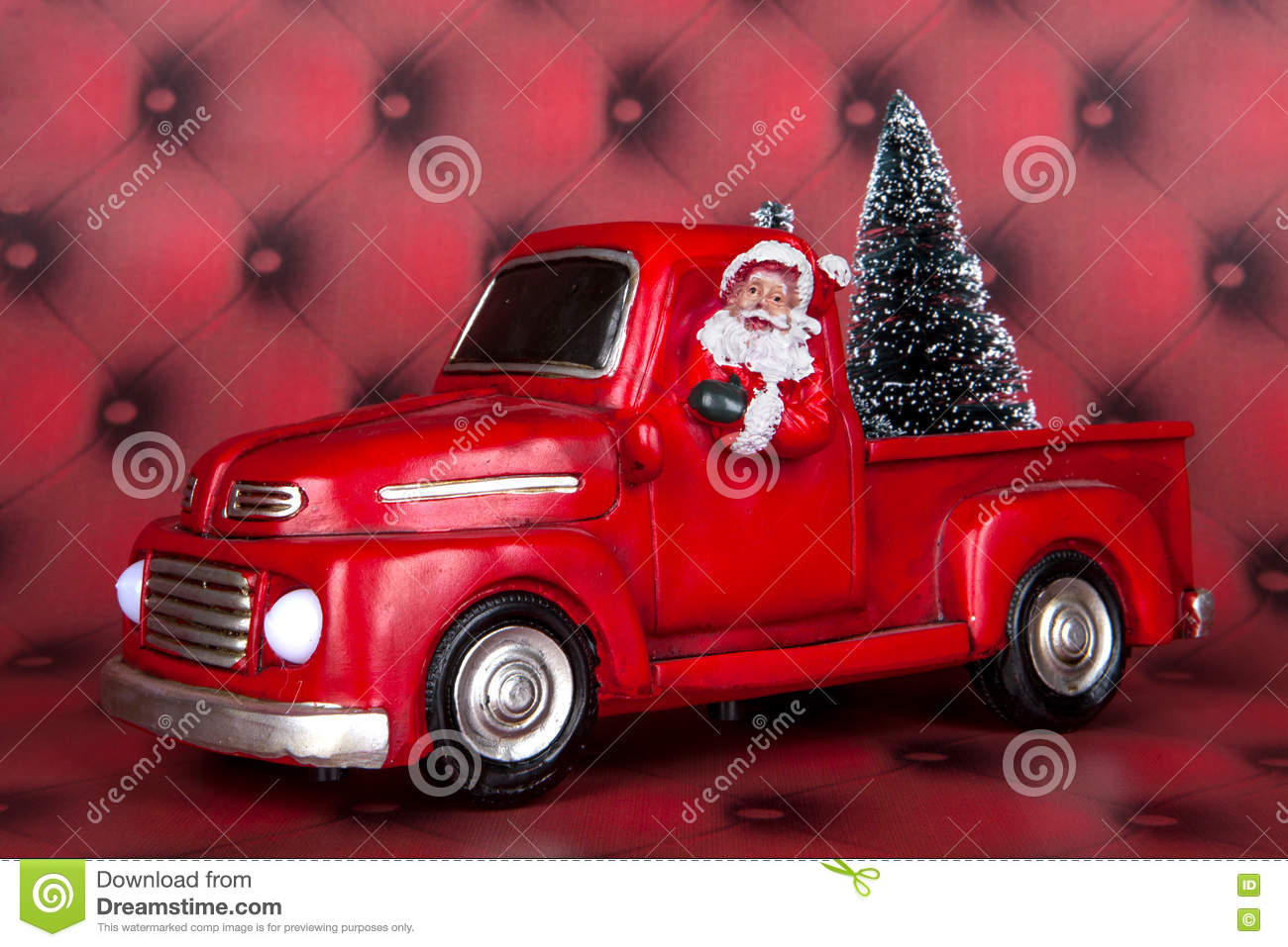 a santa claus and truck decoration for christmas