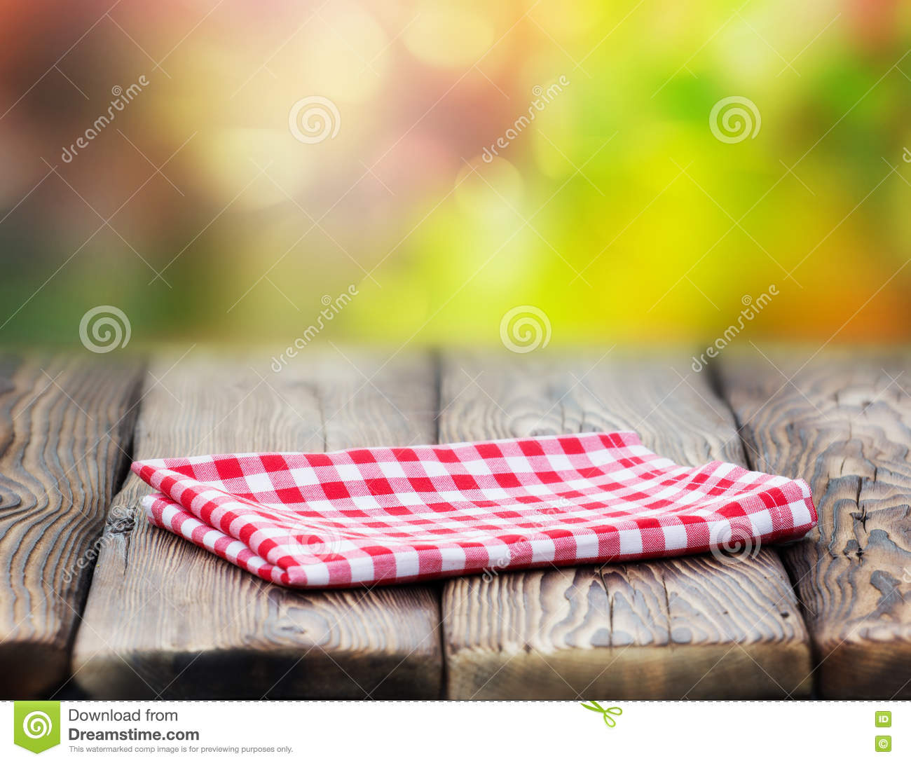 Red Picnic Cloth On Wooden Table Mature Bokeh Background ...