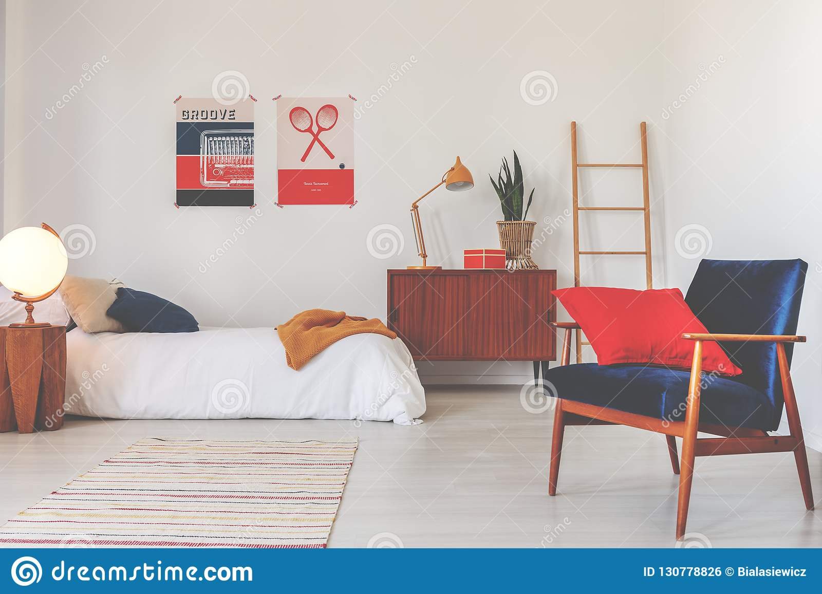 Red Pillow On Blue Armchair In White Bedroom Interior With ...