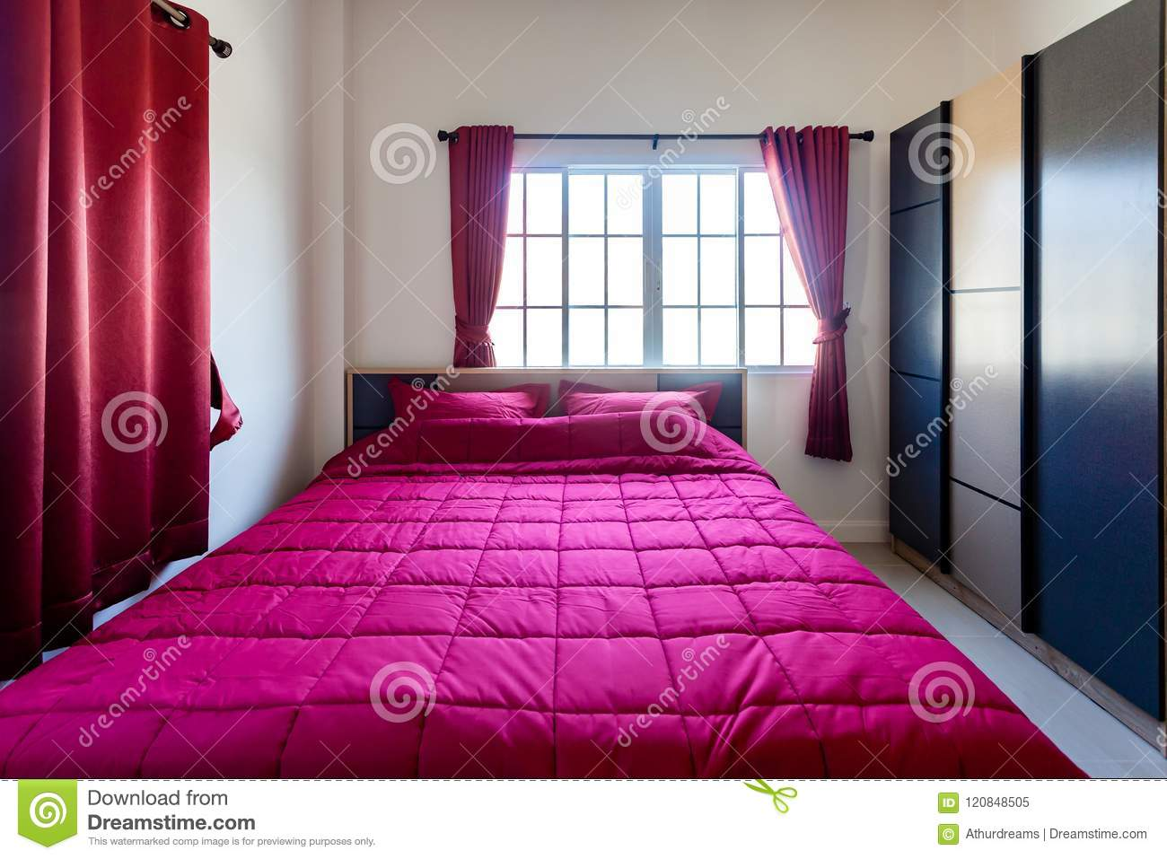 Red Pillow And Red Blanket With Red Curtain In The Bedroom With