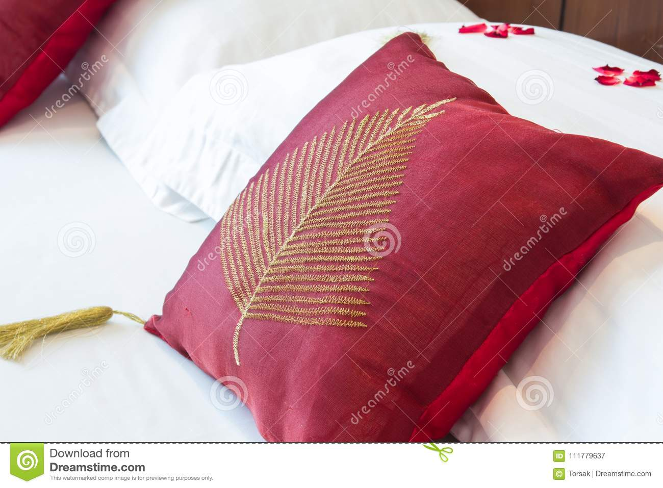 Red pillows on a bed