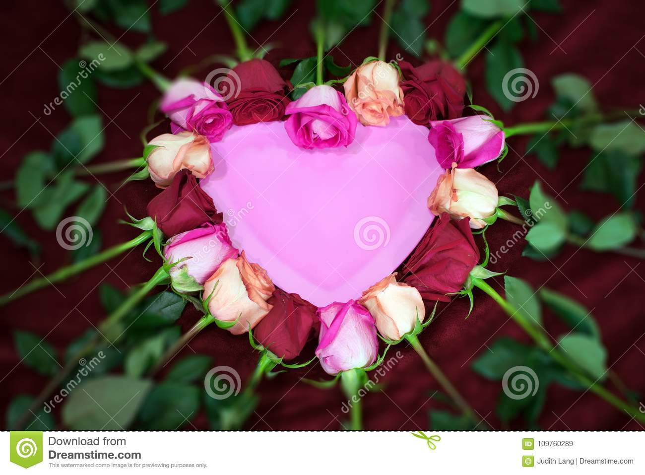 Red and pink roses form a heart shape