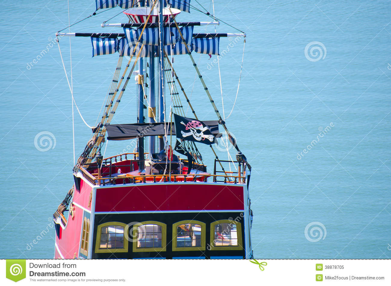 Red pirate ship with Jolly Roger flag closeup