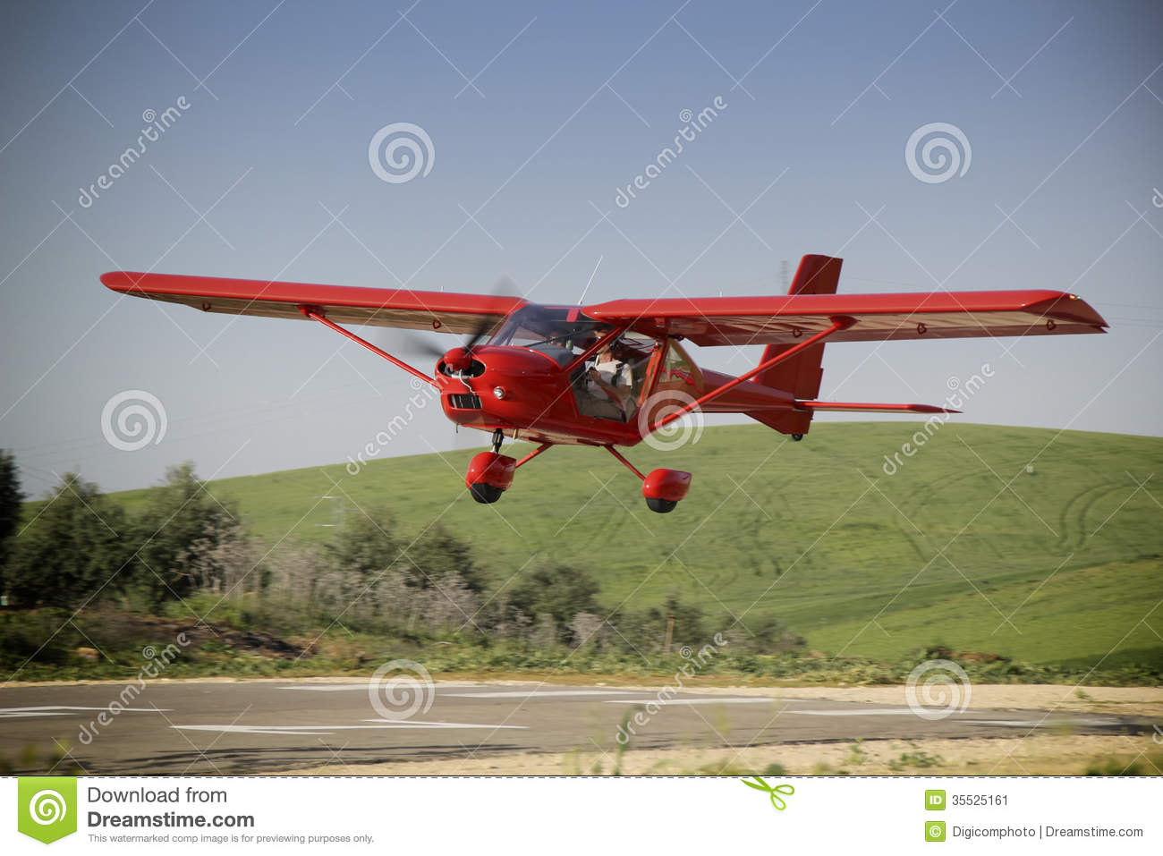 Red plane manned by student and teacher of a class flight practice, Jaen, Andalusia, Spain
