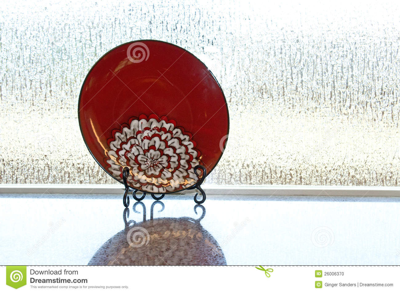 Red Plate Displayed On Stand On Counter
