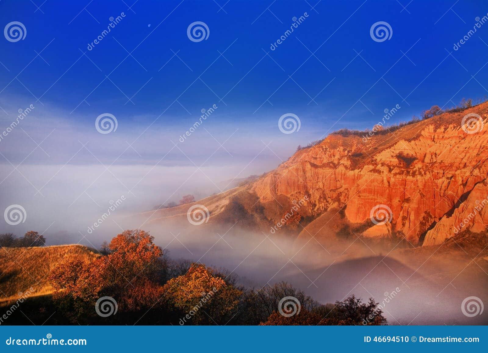 Red Ravine shrouded in fog stock photo  Image of peak - 46694510
