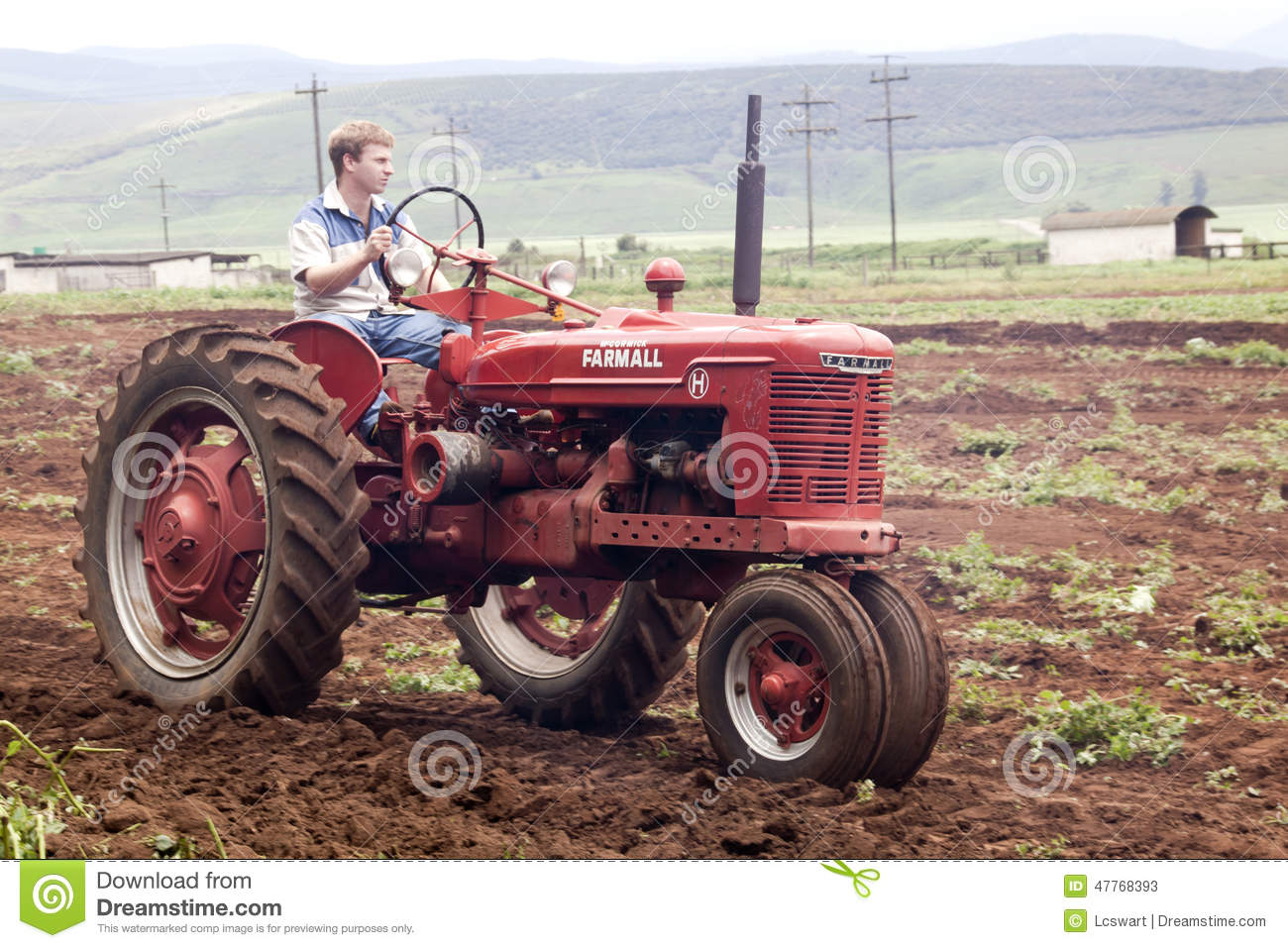 Restored Antique Tractors : Red restored vintage tractor ploughing agricultural field