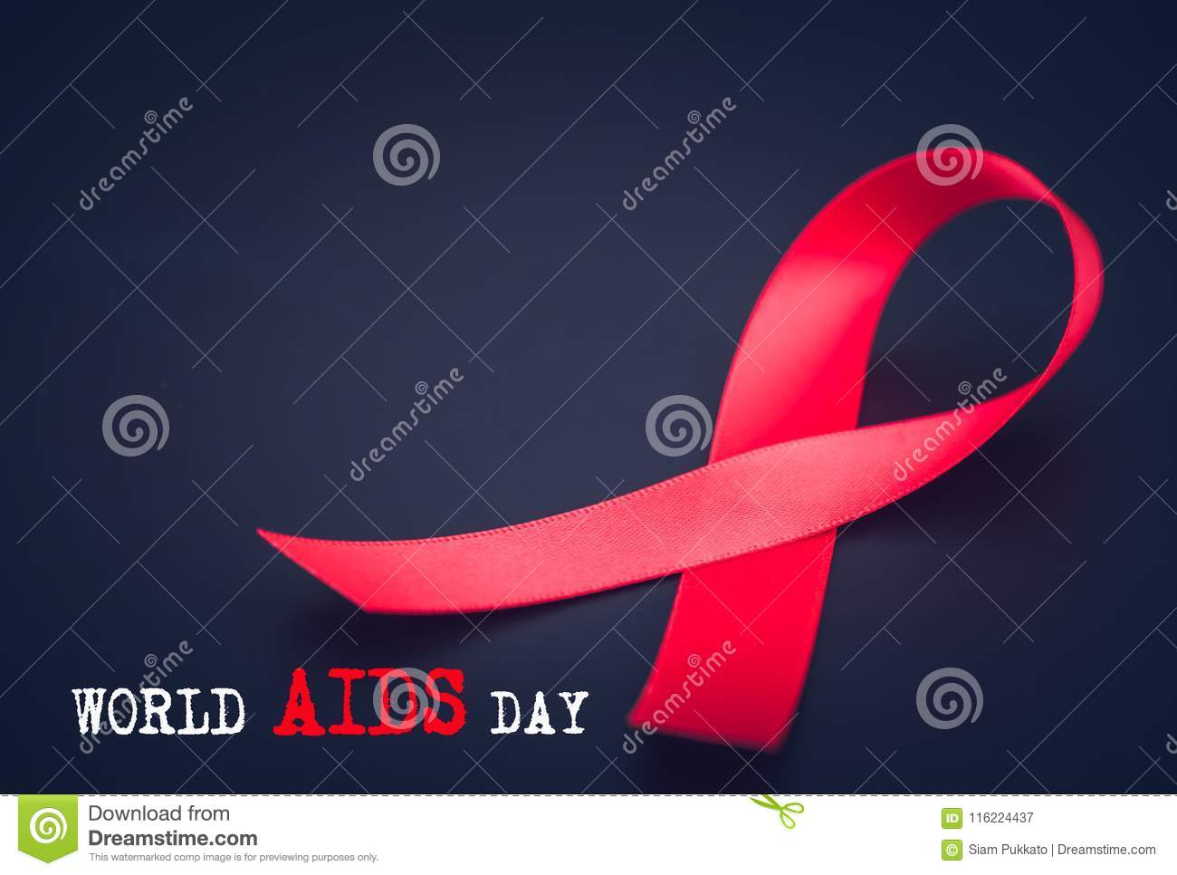 48d5663c6ef Red ribbon awareness on black background for World Aids day campaign.