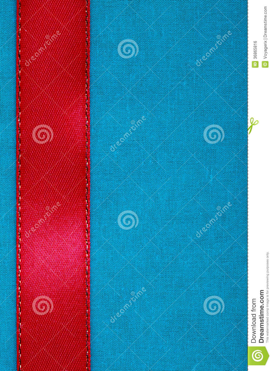 red ribbon on blue fabric background with copy space