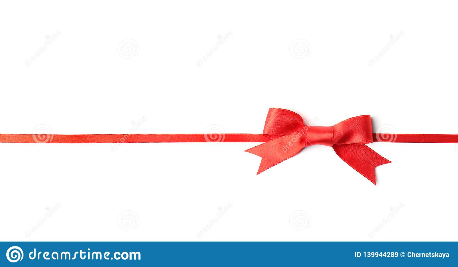 Red ribbon with bow on white. Festive decoration