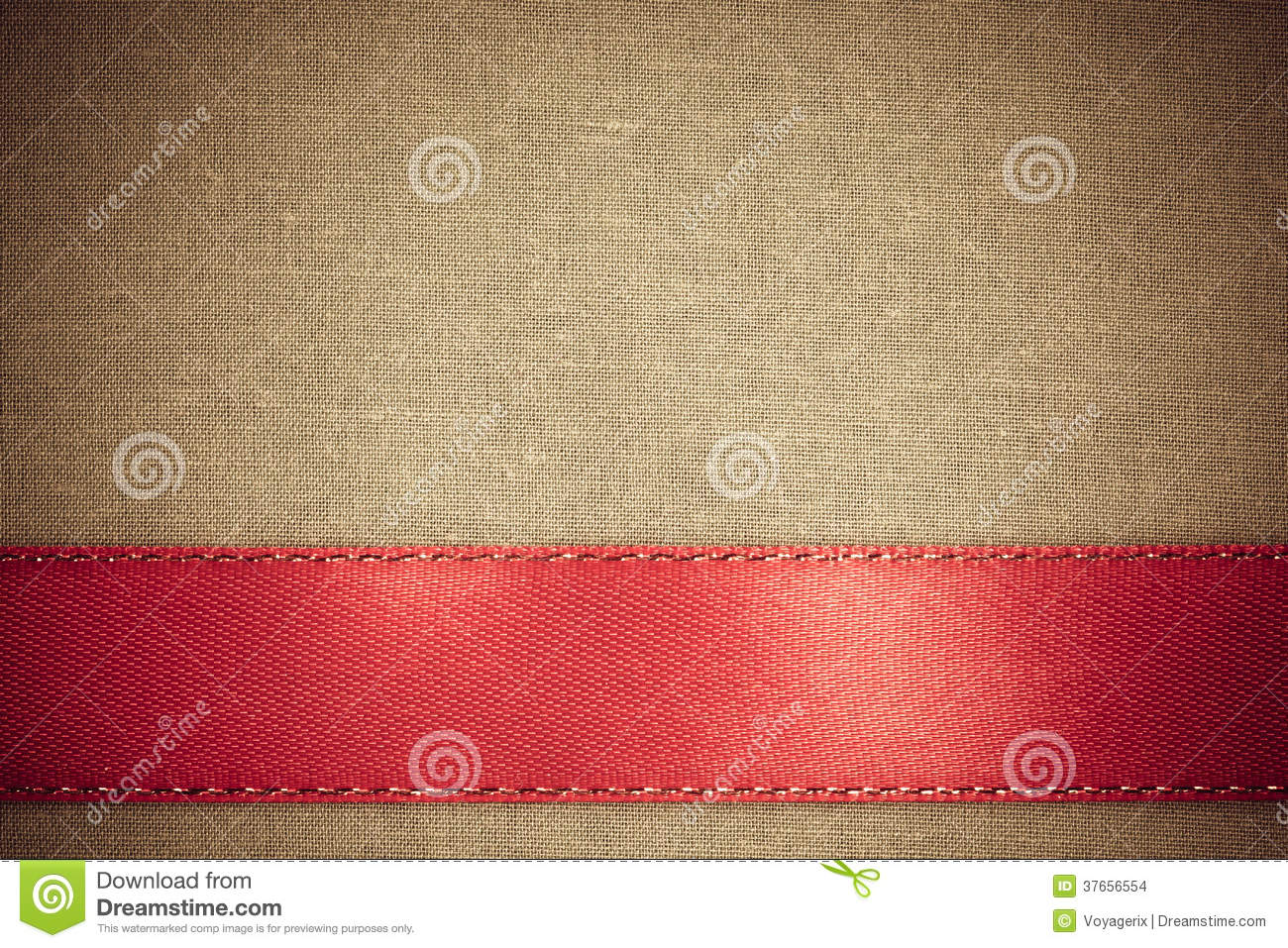Red ribbon on brown fabric background with copy space for Red space fabric