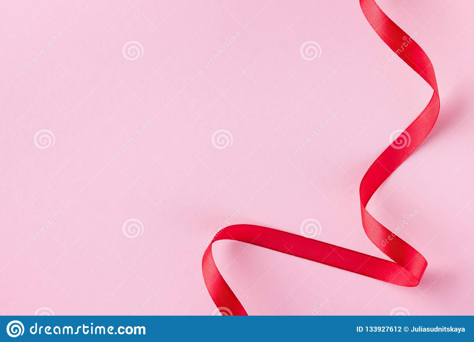 Red Ribbon On Pink Pastel Background For Valentines Day Card Flat