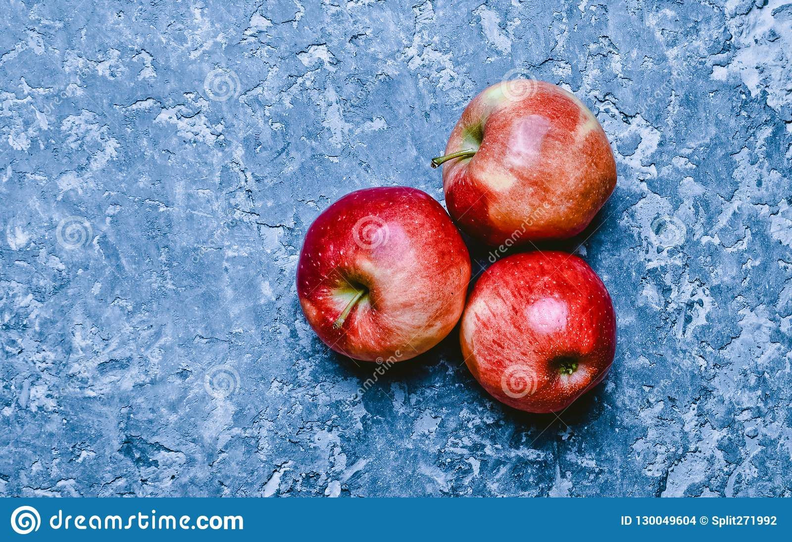 Red ripe apples on a concrete table. Fresh fruits. Loft and rust