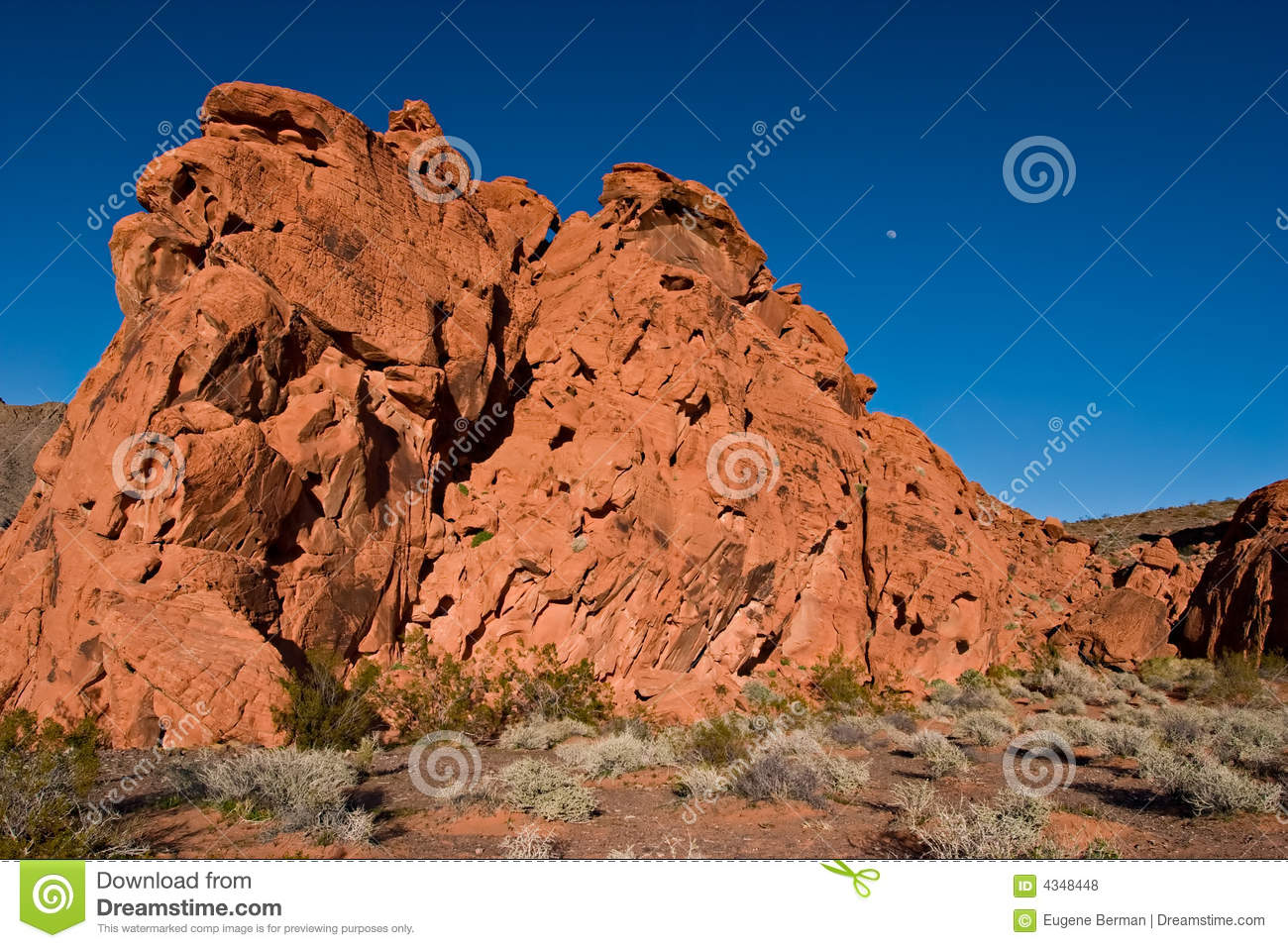 Red rock and moon