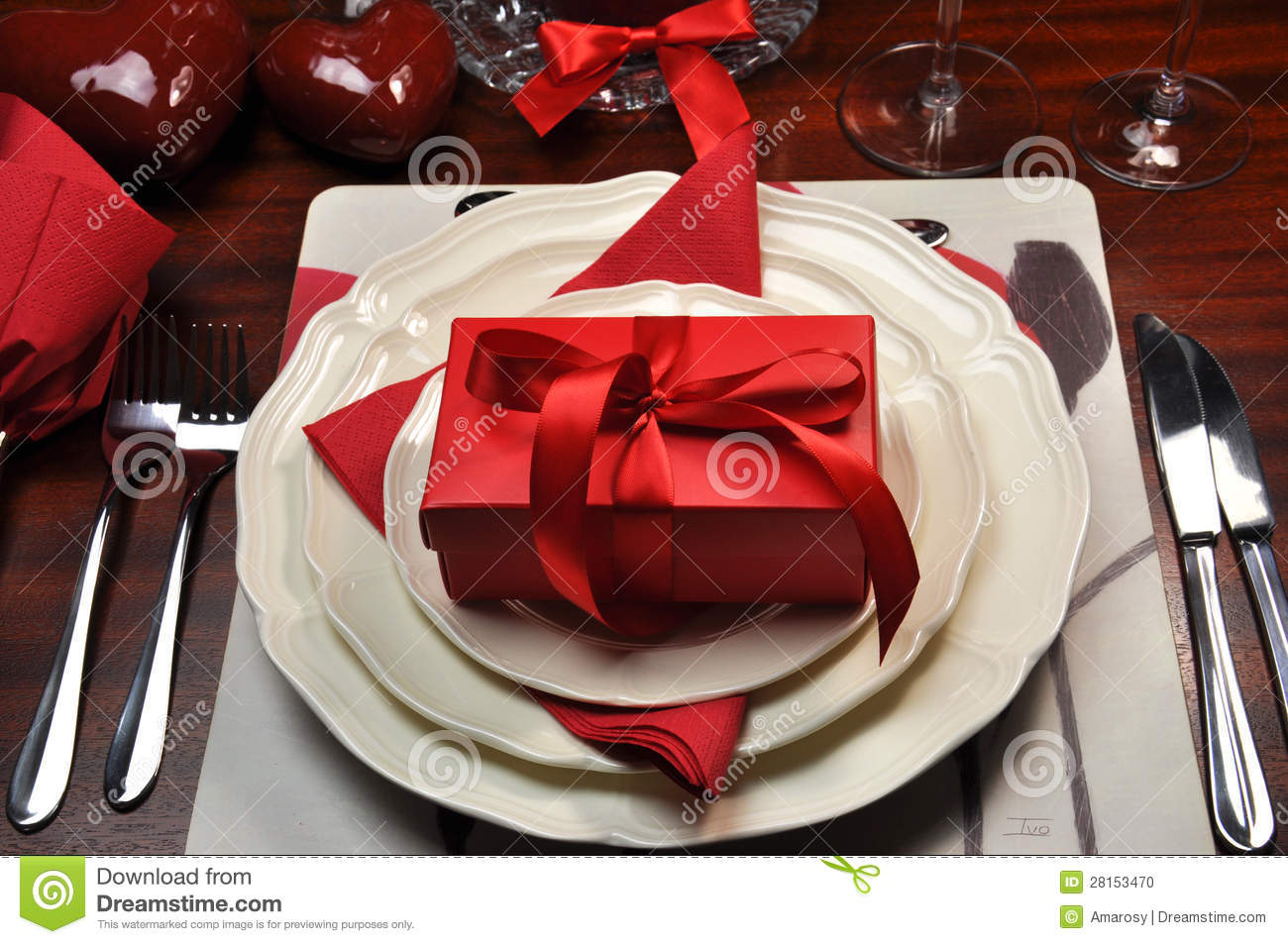 Red Romantic Dinner Table Setting With Gift Stock Photo ...
