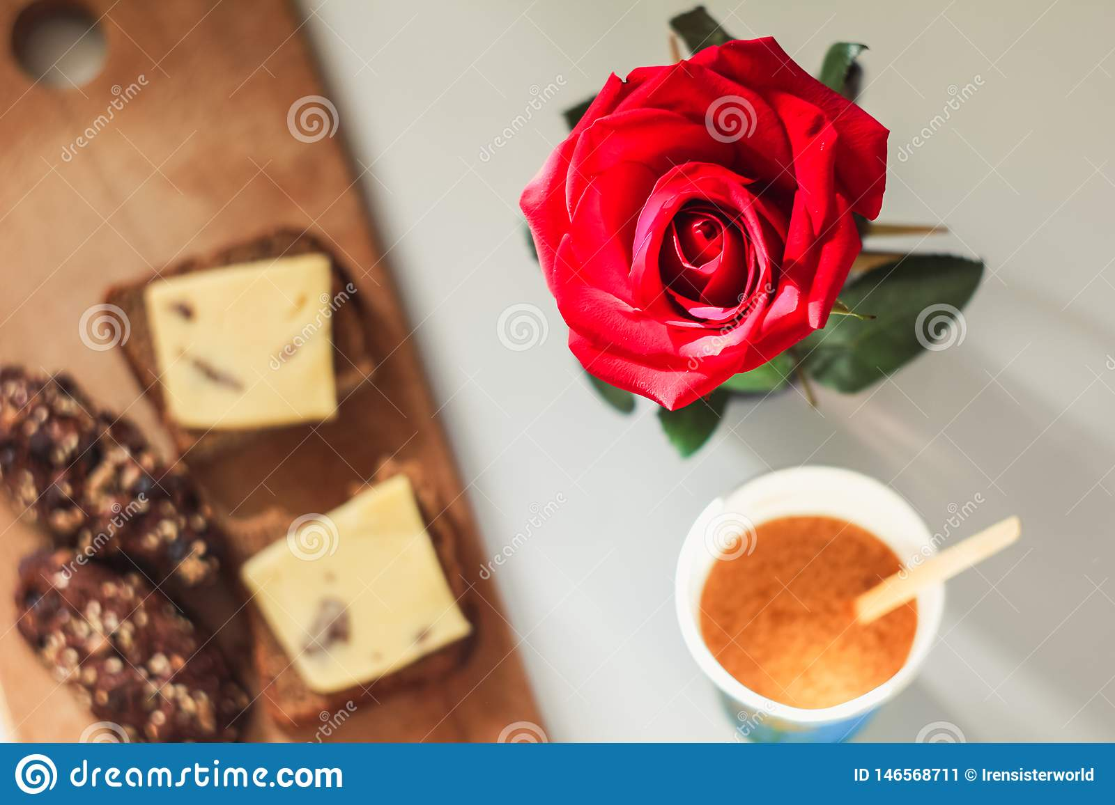 Rose on a blurred background of breakfast