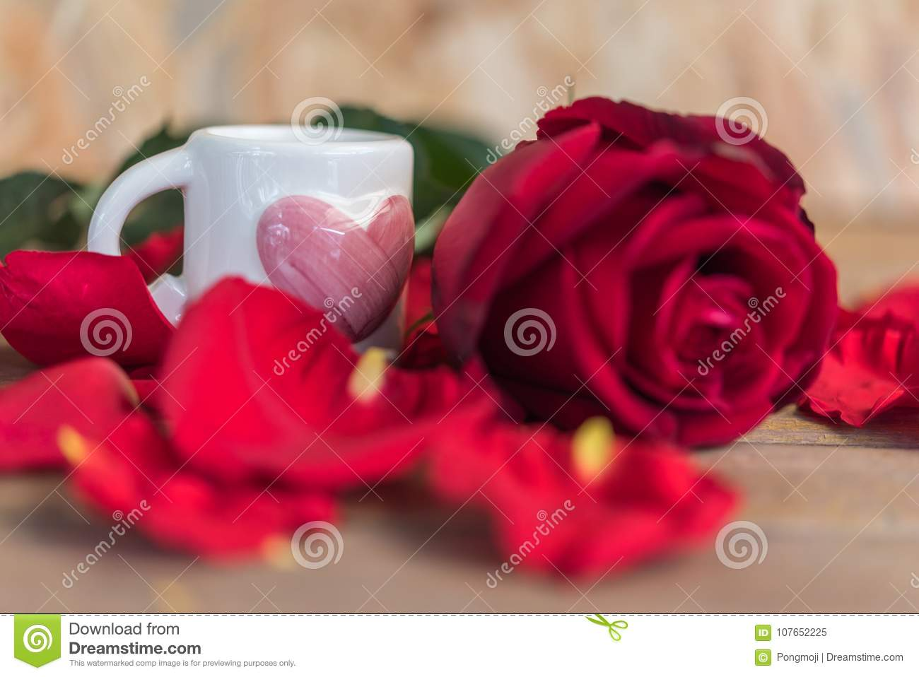 Red rose flower on wooden floor in valentines day stock image red rose flower nature beautiful flowers from the garden and petal red rose flower and white cup pink heart shape on wooden floor with copy space in izmirmasajfo