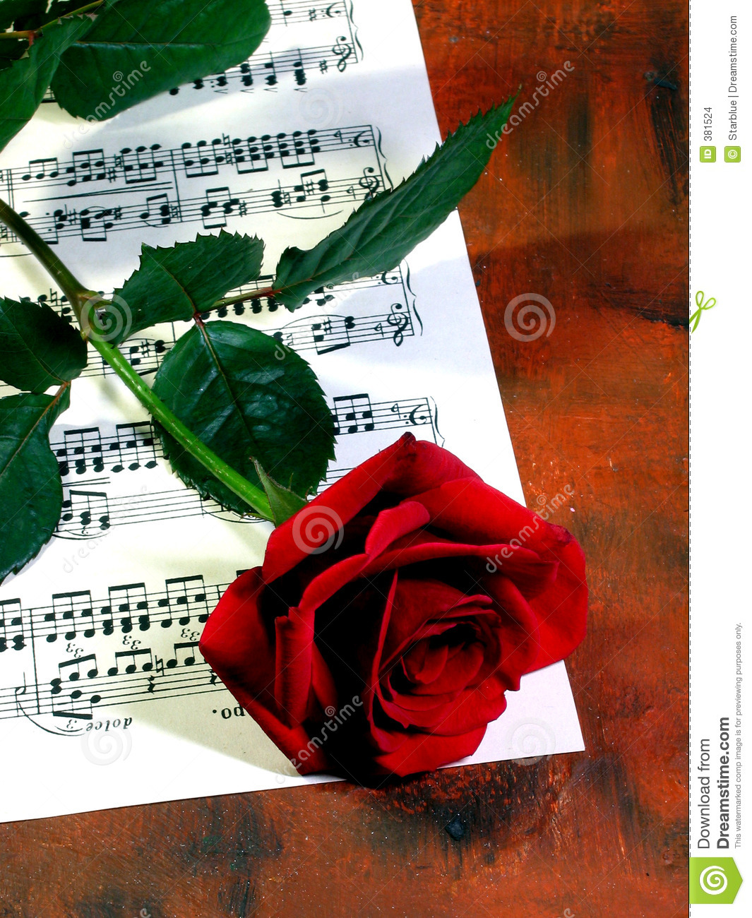 Red rose and music sheet