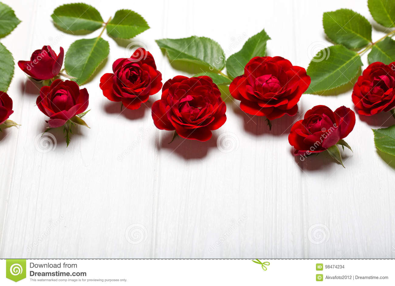 Red roses beautiful flowers on a white deoevian table stock photo download red roses beautiful flowers on a white deoevian table stock photo image izmirmasajfo