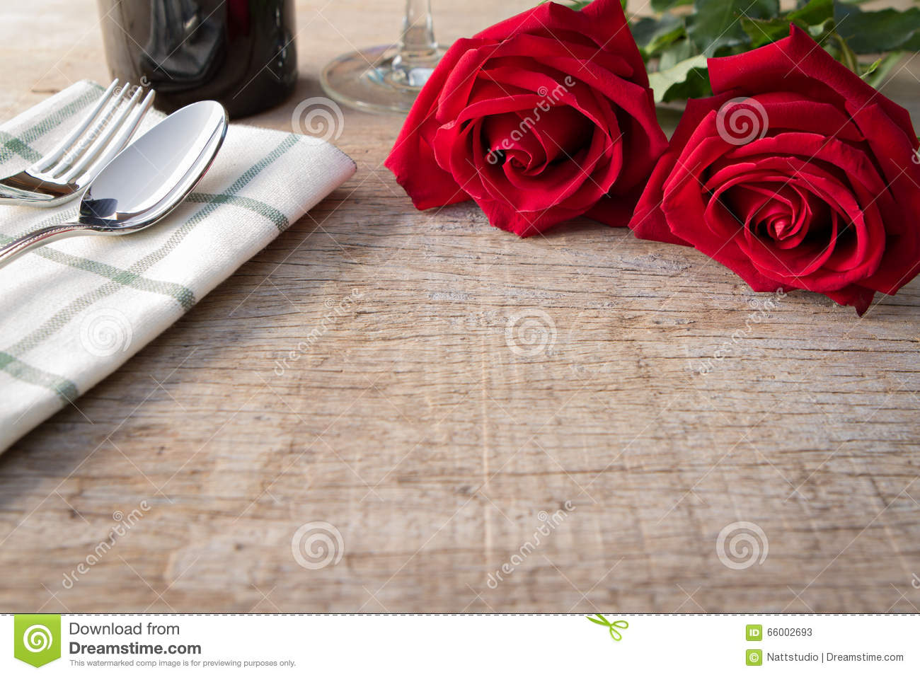 Red roses on dining table. Valentine s Day, anniversary etc.