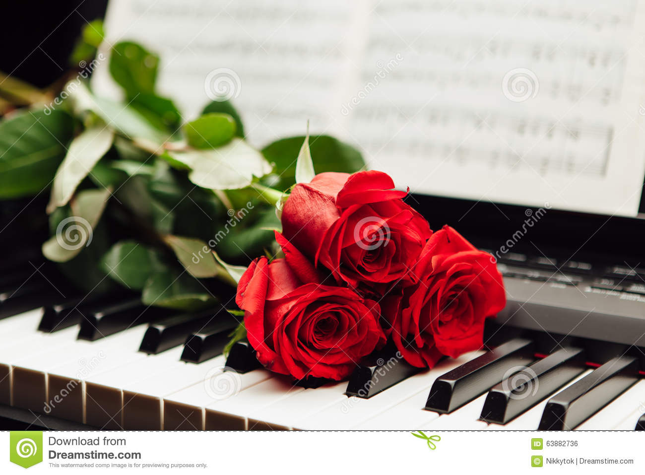 Red Roses On Piano Keys And Music Book Stock Photo Image