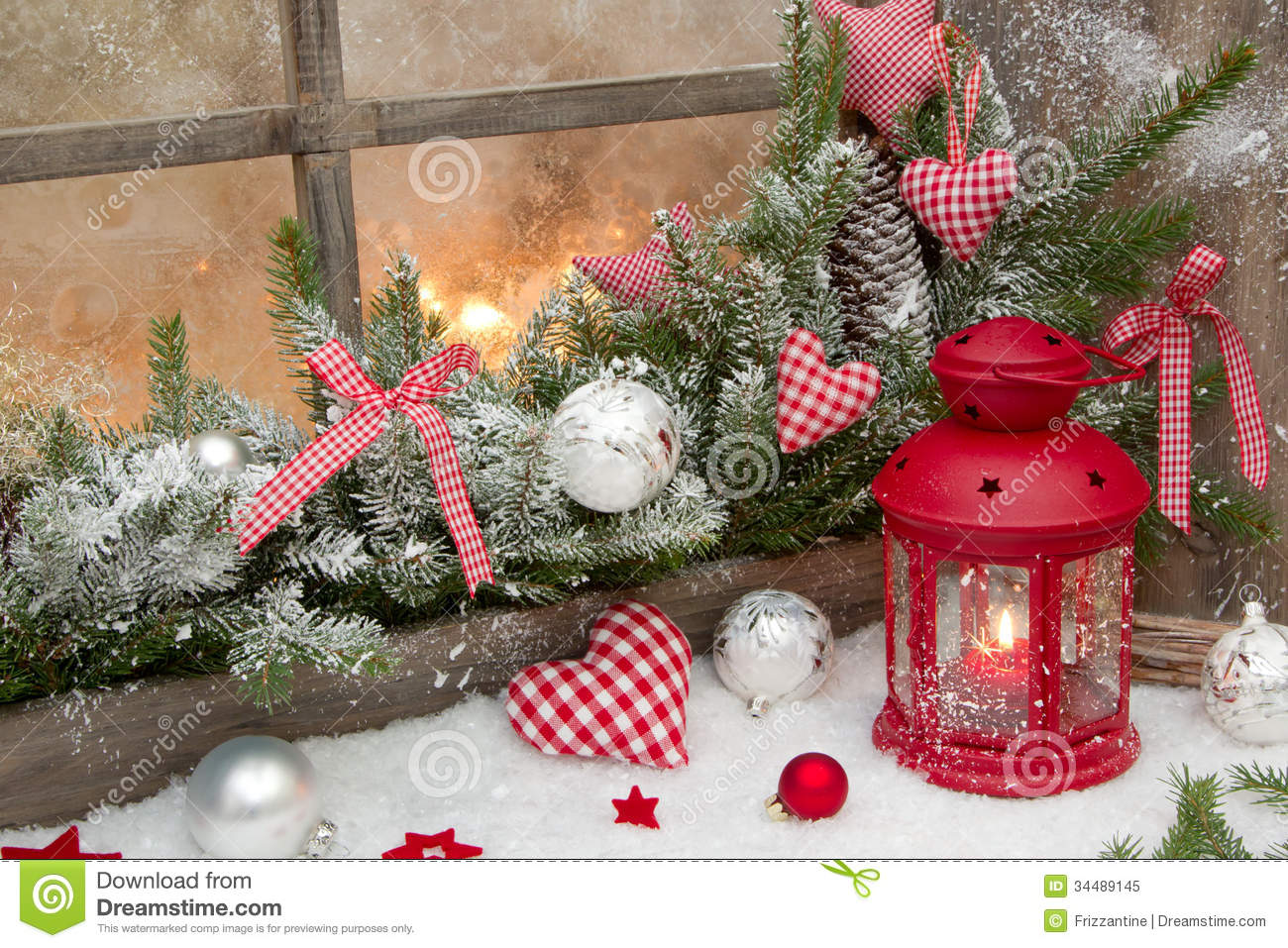 Red Rustic Christmas Decoration On Window Sill With Red
