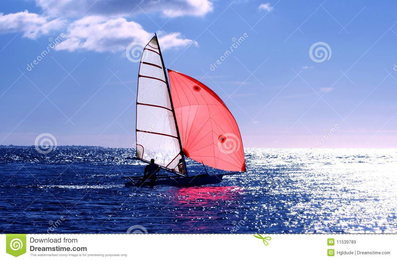 Red sail dinghy