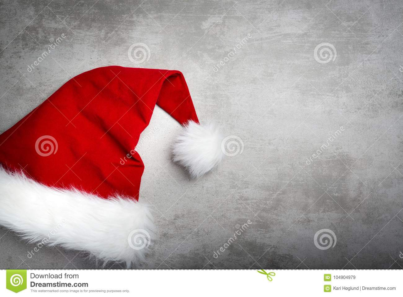Red santa hat on a gray concrete table