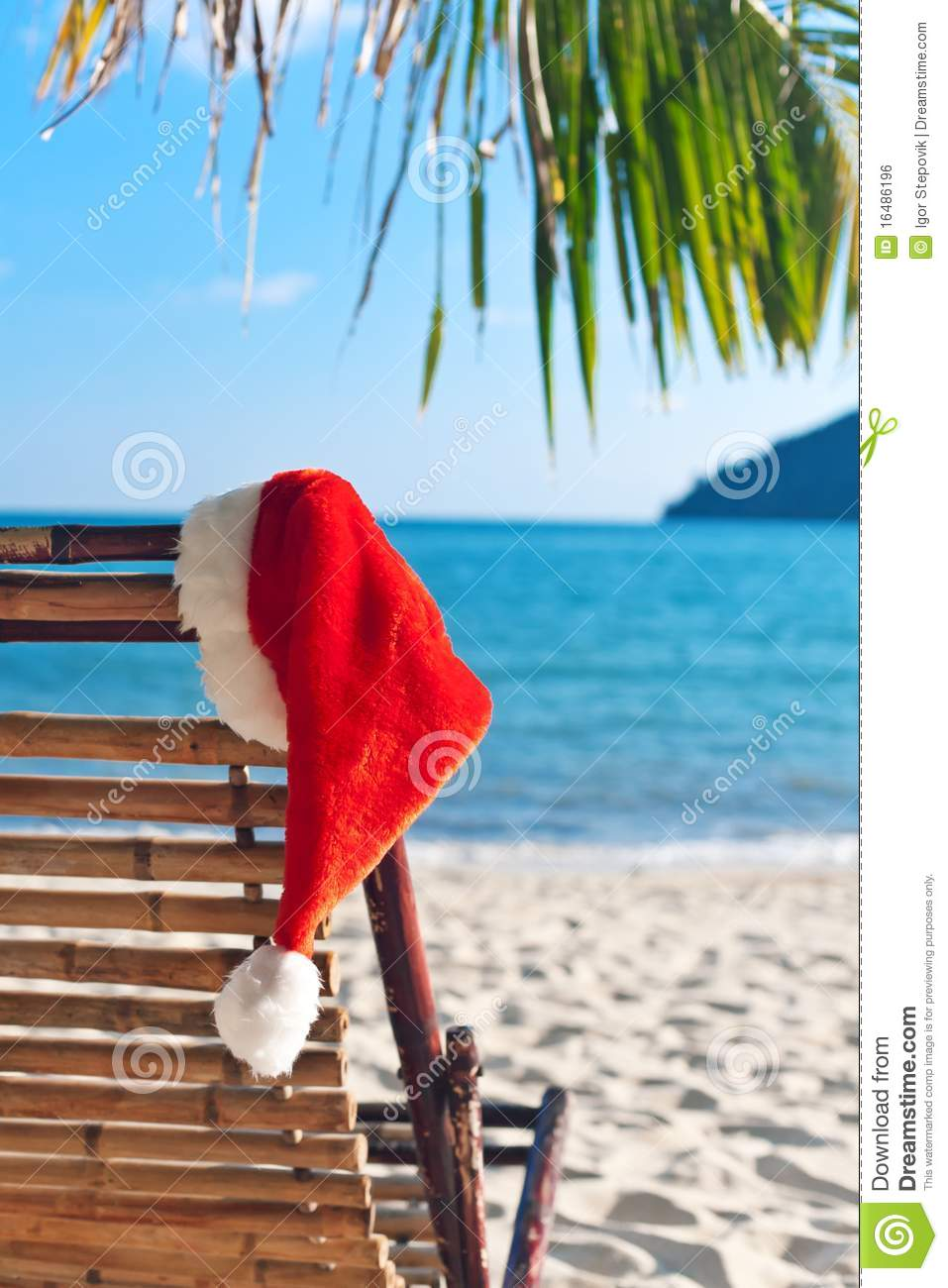 Red Santa s hat hanging on beach chair