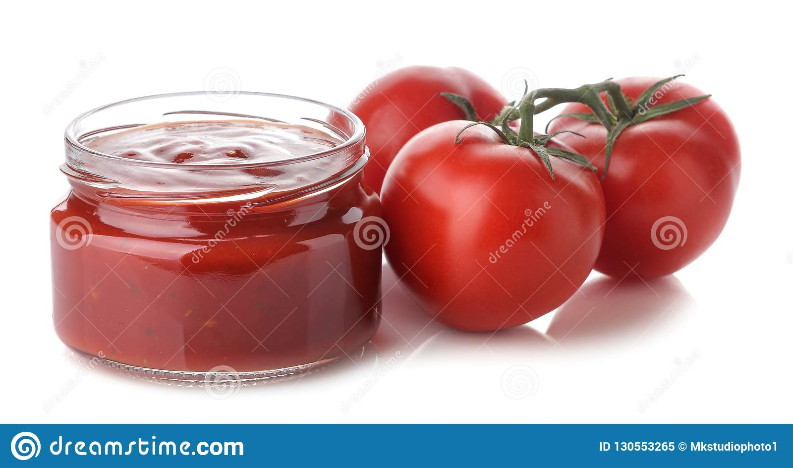 Red sauce in a jar and fresh ingredients, tomatoes on a white isolated background. Tomato sauce. Ketchup