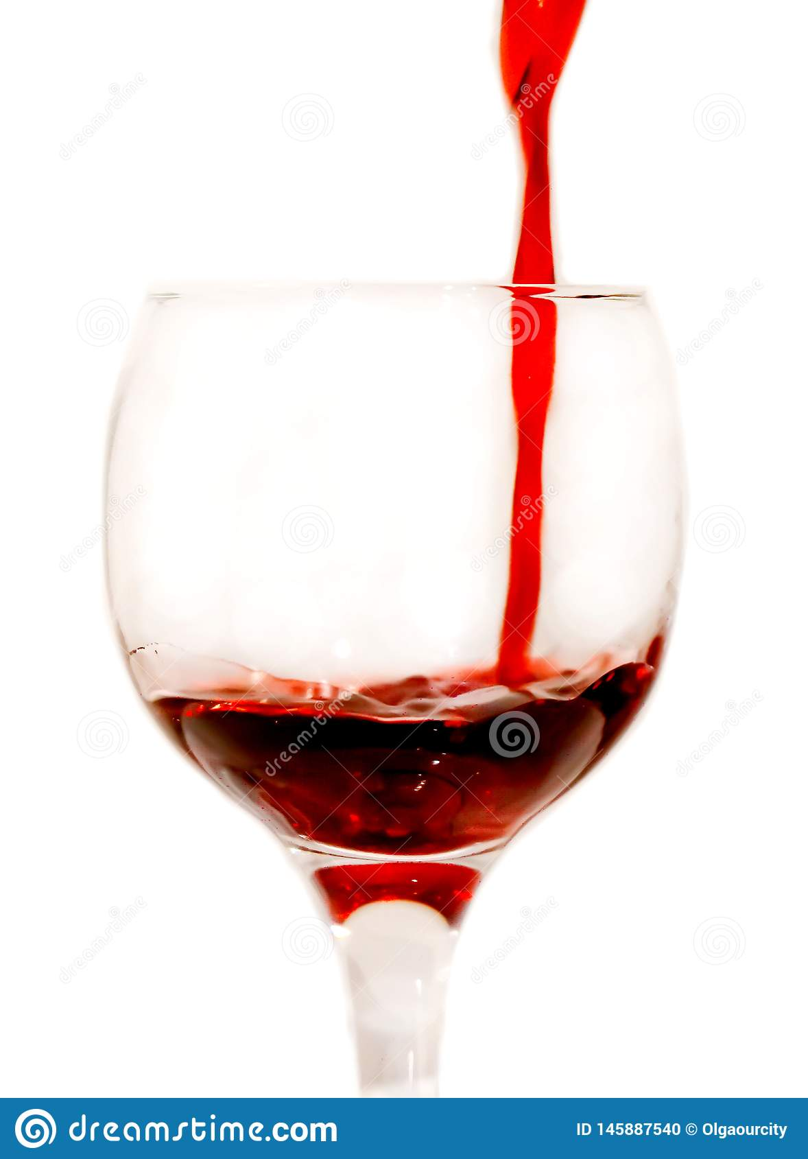 Red scarlet wine is poured into a glass