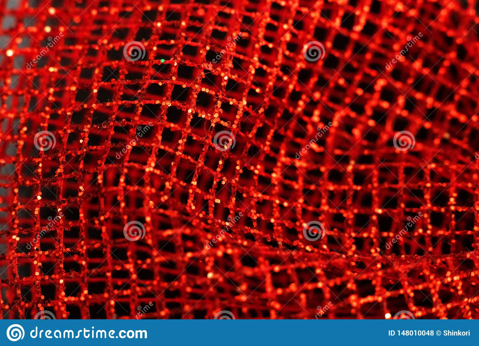 Red shiny mesh gift wrapping close up