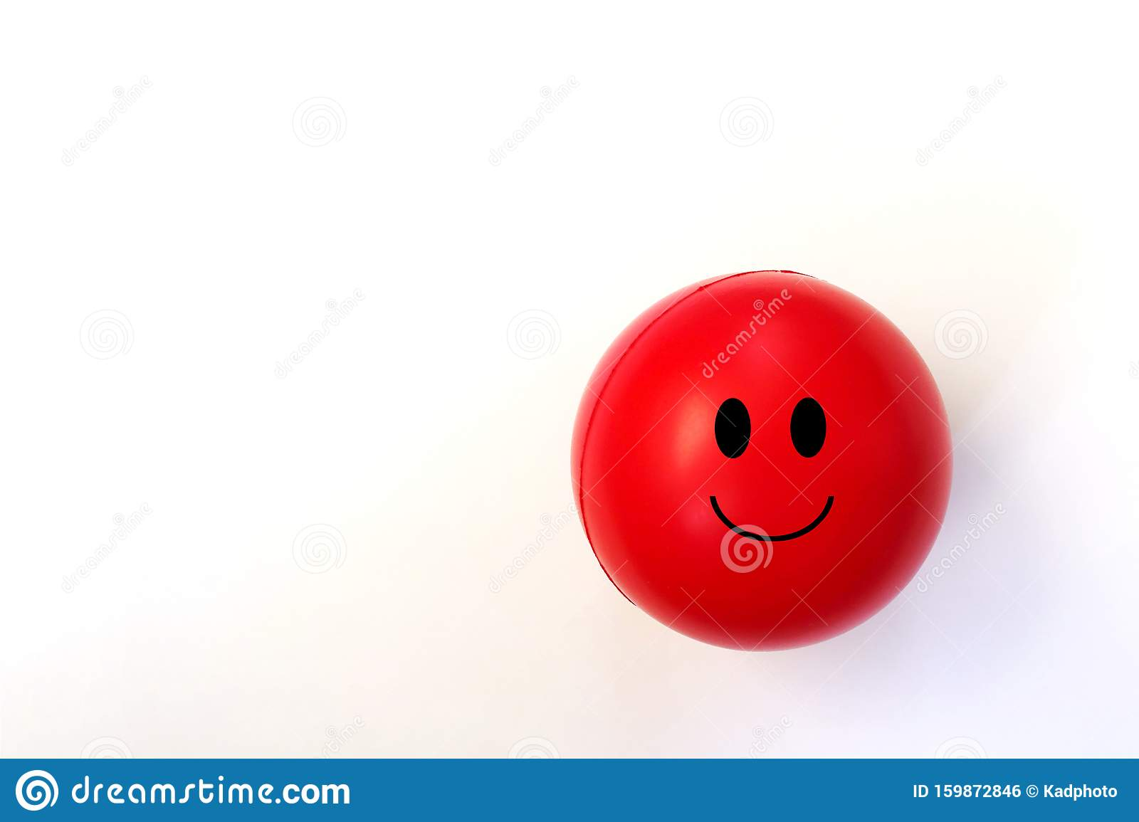 Red Smiling Emoji Ball against a White Background