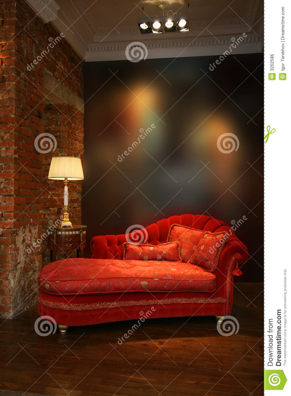 Red sofa and lamp