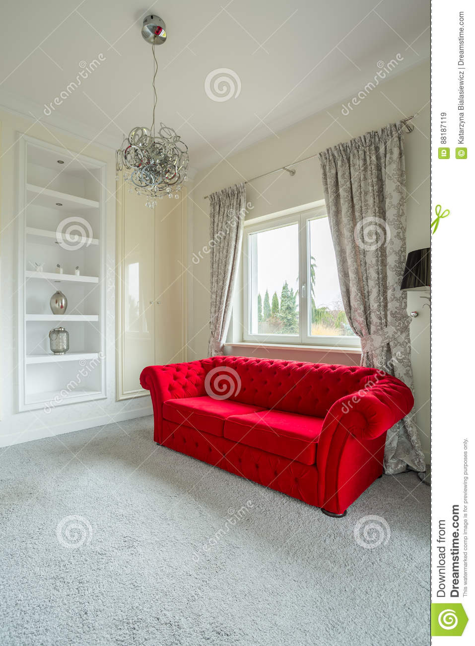 Comfortable red sofa in a grey and white lounge